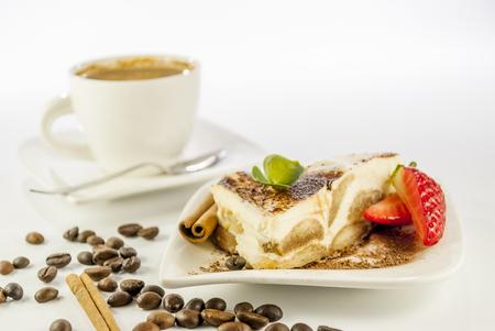 italian desert tiramisu with coffe and strawberry on white background photo