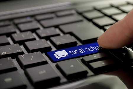 blue chat social network button or key on black keyboard photo