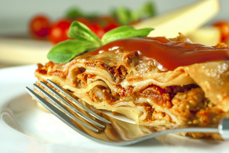 Lasagne with tomato and vegetables and chesse on wood table Imagens