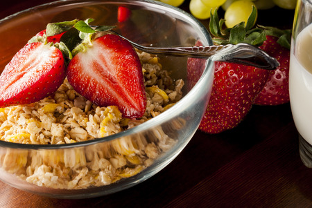 musli: Musli with strawberry and grapes on wood table Stock Photo