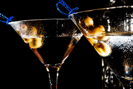 martini glass: Martini glass with olive on black background