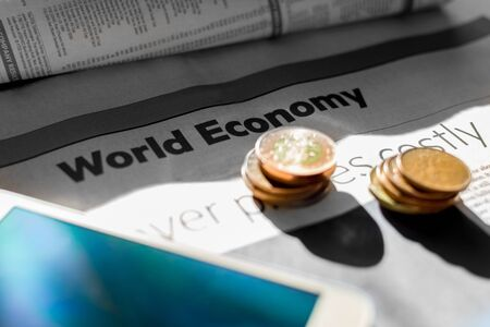 broadsheet newspaper: Coins and newspaper with inscription world economy