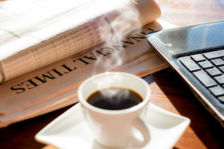 broadsheet newspaper: Coffee and notebook and newspaper with inscription financial time Stock Photo