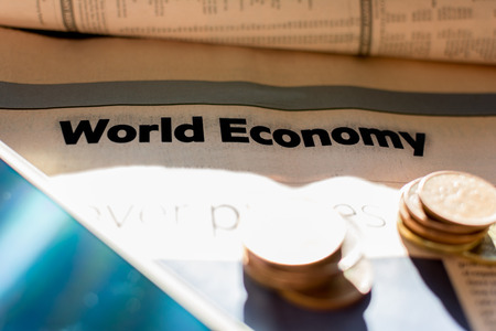broadsheet: Coins and newspaper with inscription world economy
