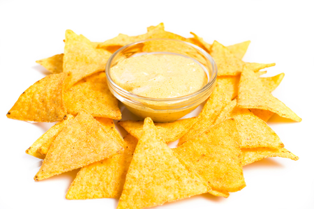 nachos: Traditional mexican nachos with cheese sauce on white