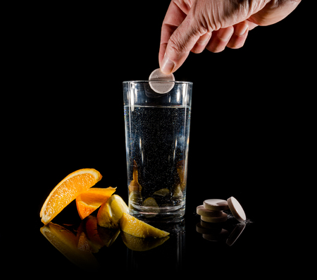 fizzy tablet: Effervescent tablets and glass of water and orange