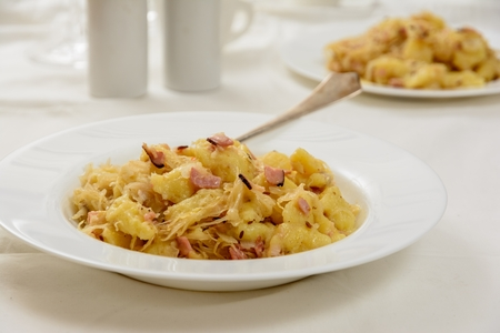 Traditional slovakian gnocchi halusky with cabbage and bacon