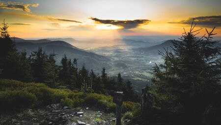 Beautiful and dramatic sunset from czech mountains Beskydy Imagens