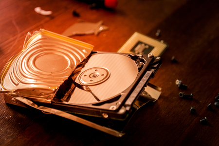 digital data: Broken and open computer or laptop hard drive Stock Photo