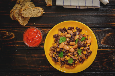 con: Traditional cuisine chili con carne with beef meat