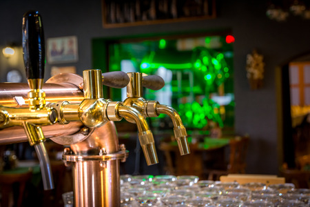 Golden chrome draught taps in a bar Stock Photo
