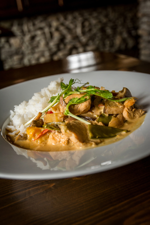 Thai chicken with vegetables and spice curry and rice Stock Photo