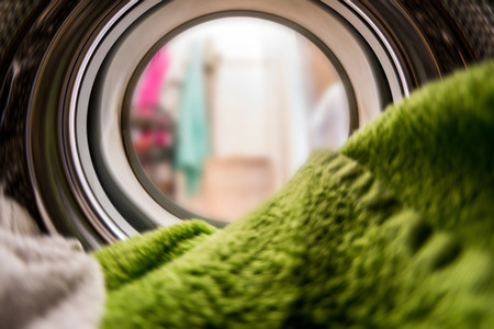 Color clothes in washing machine. inside view Stockfoto