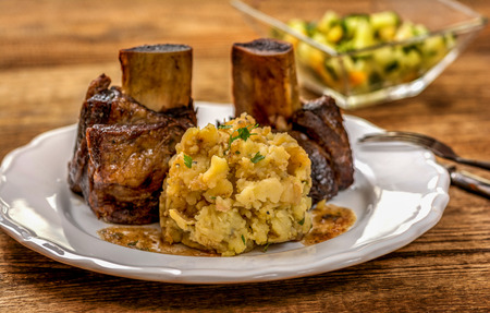 Grilled beef rib with mashed potatoes on wood table