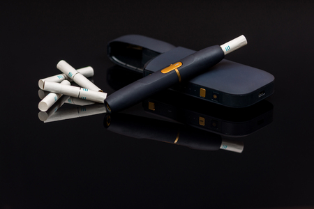 PElectronic cigarette, tobacco heating system  on black background Archivio Fotografico