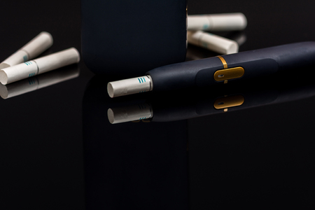 Electronic cigarette, tobacco heating system  on black background Stock Photo