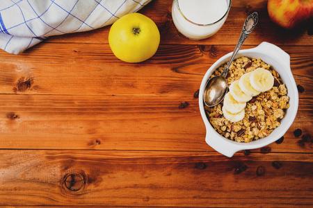 Healthy breakfast. Muesli with banana,raisins and milk top view