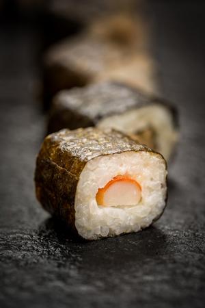 Traditional japanese sushi rolls  hosomaki on stone desk Stock Photo