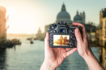 Man taking photo of Church Saint Mary of Health and Grand canal in beautiful city Venice Archivio Fotografico