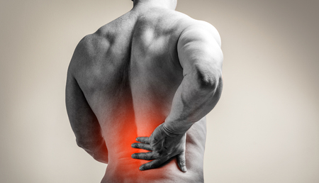 Muscle man with pain in his back. Red color zone is the pain. Medical concept on gray background Stock fotó