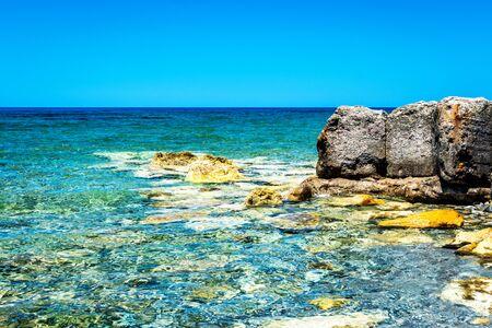 Ocean beach  on the Crete in sunny day