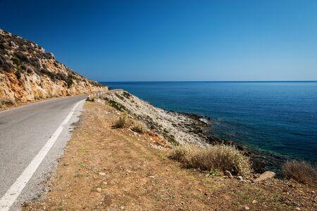 Road near Ocean beach  on the Crete in sunny day