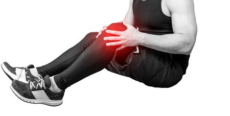 Muscle man holds his injured knee isolated on white background. Red color is pain