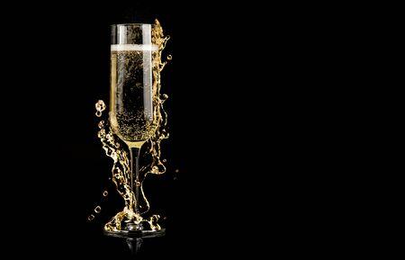 champagne glass with splash on black background - new year celebration Stockfoto