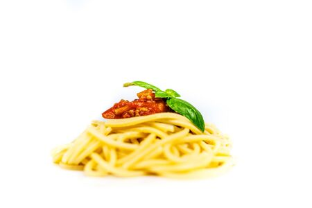Italian pasta spaghetti bolognese with basil isolated on white background Фото со стока - 134457185