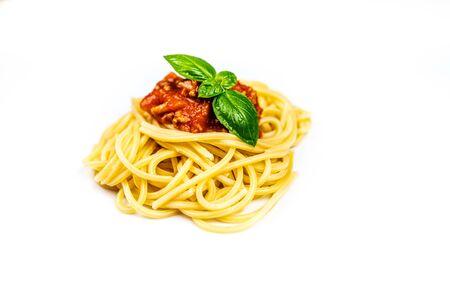 Italian pasta spaghetti bolognese with basil isolated on white background