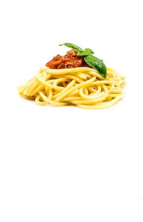 Italian pasta spaghetti bolognese with basil isolated on white background Фото со стока - 134455883