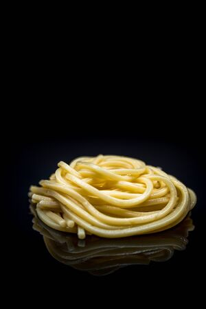 Italian pasta spaghetti  with reflect on black background