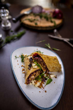 Tortilla with pork meat and red cabbage Archivio Fotografico