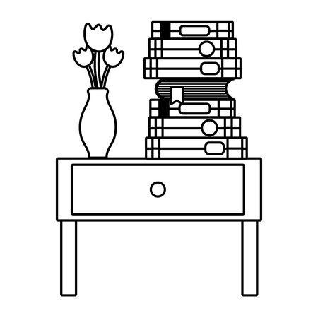 line books and flowers vase in the table end