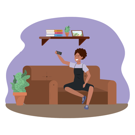 Millenial person sitting in couch using smartphone social media procrastination overalls afro taking selfie indoors background frame vector illustration graphic design Иллюстрация