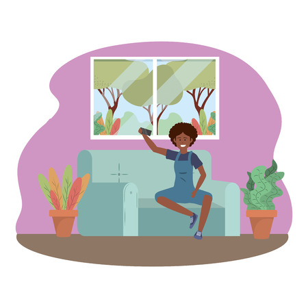 Millenial person sitting in couch using smartphone social media procrastination overalls afro taking selfie indoors background frame vector illustration graphic design