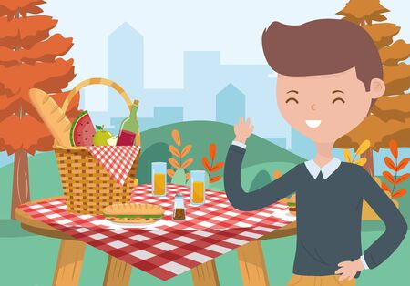 young man picnic basket food table tablecloth nature cityscape Archivio Fotografico - 133722641
