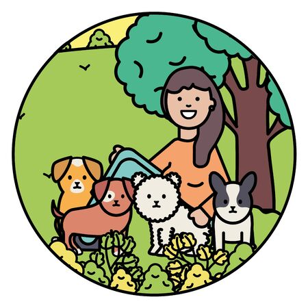 young woman with little dogs in the park