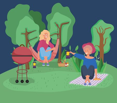 woman in hammock and other with lantern picnic