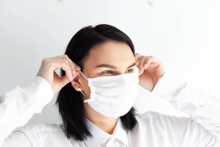 woman in medical mask on a white background