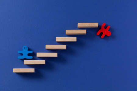 human figure climbing stairs, concept of career growth and job loss, unemployment, classic blue background Banque d'images
