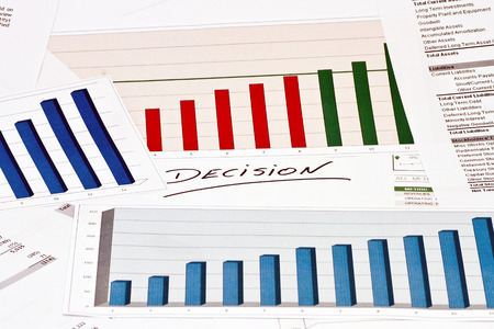 decission: Decision on financial charts and graphs Stock Photo