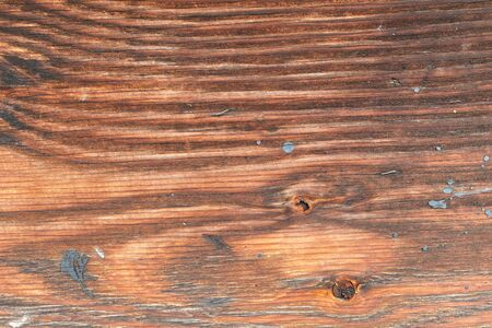 a vintage piece of wood with knots and rusty nails Stock Photo
