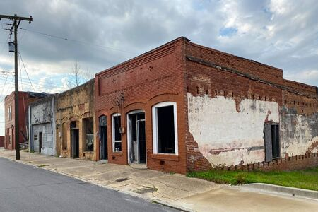 a deserted small town main street with empty buildings