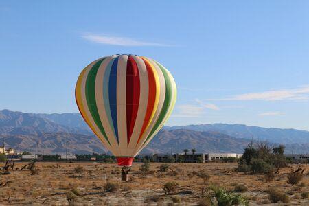 a hot air balloon desert nature blue sky scene