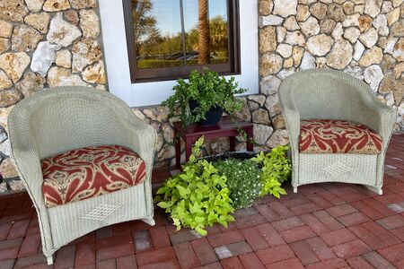 pair of southern style cobblestone porch chairs