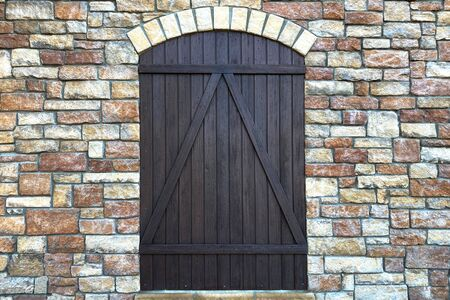 a medieval gothic stone building with old wooden door Stock Photo