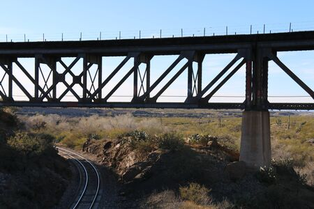 a desert railway bridge crossing of 2 lines