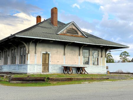 an unowned old abandoned train station building in a ghoat town