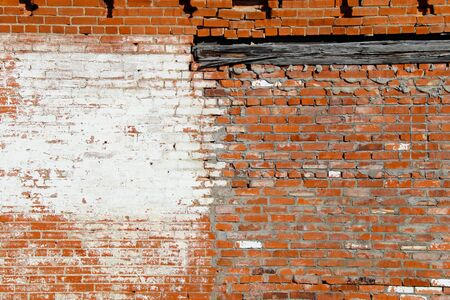 an old abandoned exterior whitewashed red brick garden building wall  Stock Photo